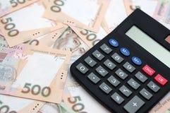 Geld met calculator Stock Foto's