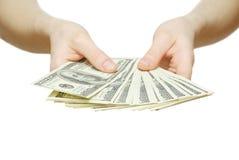 Geld met hand Stock Afbeelding
