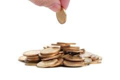 Geld mit der Hand Lizenzfreie Stockfotografie
