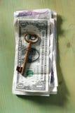 Geld onder slot en sleutel Stock Afbeeldingen