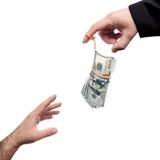 Geld op de meester van marionettenvinger stock fotografie