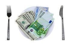 Geld op de plaat Stock Foto