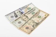 Geld op de witte achtergrond stock afbeeldingen