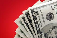 Geld op rode Achtergrond Stock Foto