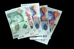 Geld op zwarte Royalty-vrije Stock Afbeelding