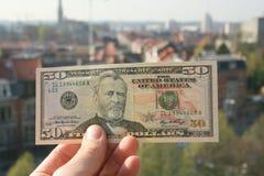Geld ordnet die Welt an lizenzfreie stockbilder