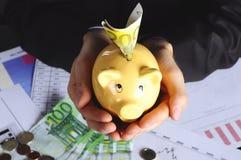 Geld in piggybank Royalty-vrije Stock Foto's