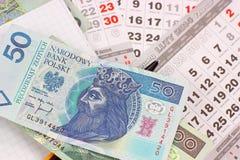Geld PLN op een kalender Royalty-vrije Stock Afbeeldingen
