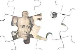 Geld-Puzzlespiel Stockbild