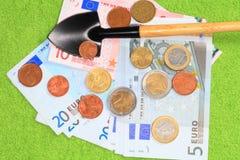 Geld, schop Royalty-vrije Stock Foto