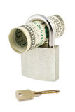 Geld, slot en sleutel stock foto