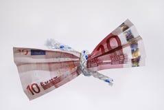 Geld - spannen Sie Ihren Gurt Stockfoto