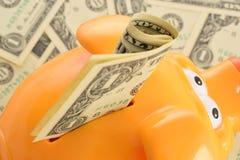 Geld sparen Arkivbild