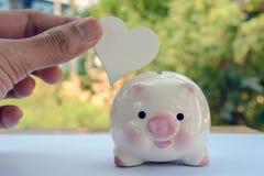 Geld sparend, speichern Sie Geldeinsparungskonzept lizenzfreie stockfotografie