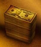 Geld-Stapel-Stapel auf Brown-Hintergrund Stockfotografie