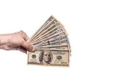 Geld ter beschikking, dat op witte achtergrond wordt geïsoleerde Stock Foto
