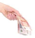 Geld ter beschikking op wit Royalty-vrije Stock Foto's