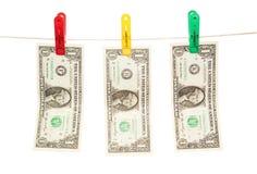 Geld trocknet auf einer Schnur Lizenzfreies Stockbild