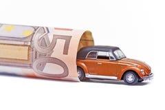 Geld u. Auto Stockfoto