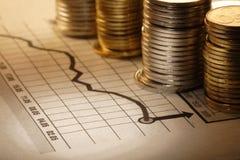 Geld und Diagramm Stockfotografie