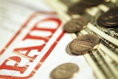 Geld und ein Empfang Lizenzfreies Stockfoto