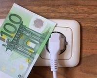 Geld und Energie Stockbild