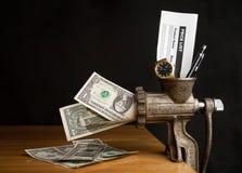 Geld und Fleischwolf Stockfoto