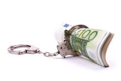 Geld und Handschellen Lizenzfreies Stockbild