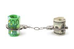 Geld und Handschellen Stockbilder