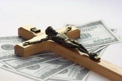 Geld und Religion lizenzfreie stockbilder