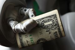 Geld und Roboter Stockfoto