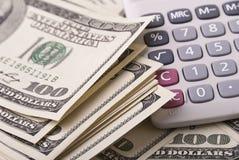 Geld und Taschenrechner Lizenzfreies Stockfoto