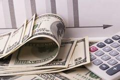 Geld und Taschenrechner Stockfoto