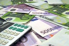 Geld und Taschenrechner Lizenzfreie Stockfotos