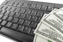 Geld und Tastatur stockfoto