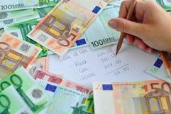 Geld und Unkosten Lizenzfreies Stockbild