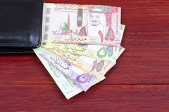 Geld van Saudi-Arabië in de zwarte portefeuille royalty-vrije stock afbeelding