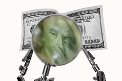 Geld vergrößert Lizenzfreies Stockfoto