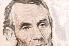 Geld vijf Lincoln Dollar Bill Stock Afbeelding