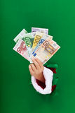 Geld voor de Kerstmis het winkelen stormloop Stock Foto's