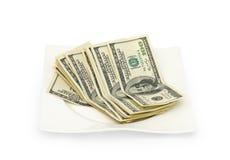 Geld zerstreut auf eine Platte getrennt Stockfotografie