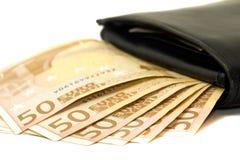 Geld in zwarte portefeuille Royalty-vrije Stock Afbeeldingen