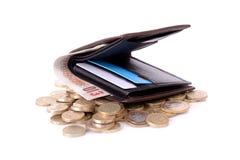 Geldbörse auf Münzen Stockfotos