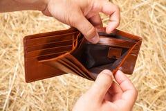 Geldbörse in den Händen Lizenzfreie Stockfotos