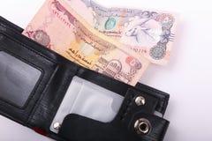 Geldbörse mit Emiratgeldpfund stockfotografie