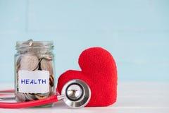Geldbesparing en gezondheidszorgconcept stock fotografie