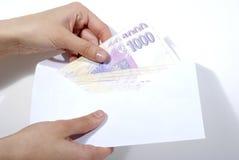 Geldbestechungsgeld Stockfotos