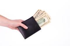 Geldbeutel mit Dollarscheinen in der Hand Stockbilder
