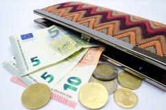 Geldbeutel mit Geld lizenzfreies stockbild