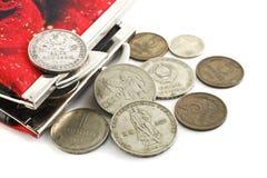 Geldbeutel und alte Münzen Stockfoto